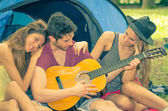 Friends having fun on camping — Stock Photo