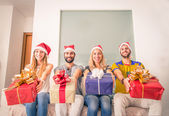 Friends with christmas presents — Stok fotoğraf