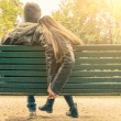 Couple in love on a bench — Stock Photo #58727029