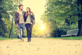 Couple walking in a park — Stock Photo