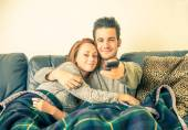 Couple of lovers watching tv — Stock Photo
