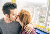 Couple on a panoramic wheel — Stock Photo