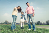 Happy family playing outdoors — Stock Photo
