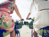 Girls on a bicycle — Stock Photo