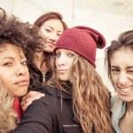 Four young beautiful girls smiling — Stock Photo #67535385