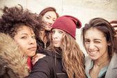 Four young beautiful girls smiling — Stock Photo
