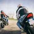 Two motorbikes driving in the nature — Stock Photo #70102441