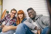 Multiracial group taking selfie — Stock Photo