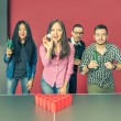 Young people playing beer pong — Stock Photo #70746133