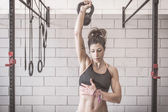 Woman training with kettle bells — Stock Photo