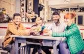 Friends drinking in a bar — Stock Photo