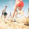 Group of friends playing soccer on the beach — Stock Photo #74154489