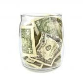 Piggy bank with dollars — Stock Photo