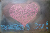 Hand drawn pink hearts on chalkboard background. — Stock Photo