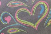 Hand drawn hearts shape on chalkboard background. — Stock Photo