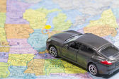 Car (small) toys on paper map — Stock Photo