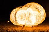 Man Fire Show on the beach  — Stock Photo
