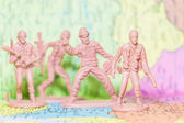 Toy Soldiers  on paper map background — Stock Photo