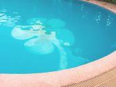 Tiles flower shape floor at swimming pool — Stock Photo