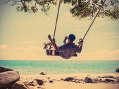 Young man swinging — Stock Photo