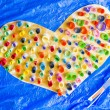 Colorful Paper Heart Hand Made From Rolled Up Pieces on Blue Background Photo — Stock Photo #64995785