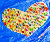Colorful Paper Heart Hand Made From Rolled Up Pieces on Blue Background Photo — Stock Photo
