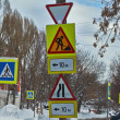Road signs at the crossroads of the winter city. — Stock Photo #61546123