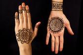 Hand with mehendi on black background — Stock Photo