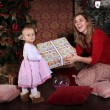 Christmas Mom gives daughter gift — Stock Photo #57731297
