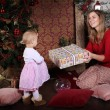 Christmas Mom gives daughter gift — Stock Photo #57731317