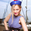 Beautiful young blond woman dressed as a sailor isolated on white background — Stock Photo #57888989