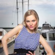 Beautiful young blond woman dressed as a sailor isolated on white background — Stock Photo #57889023
