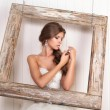 Beautiful girl the bride on a background of bright stucco — Stock Photo #69891979
