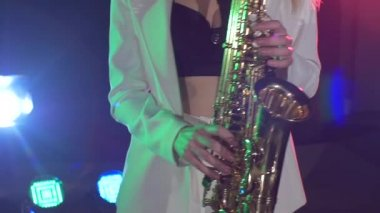 Woman playing music using saxophone — Stock Video