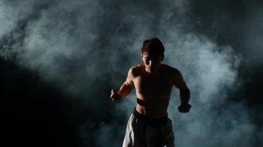 Karate man doing exercises — Stock Video