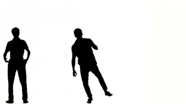 Two hip hop acrobatic break-dancers stylish men dancing, on white, silhouette — Stock Video