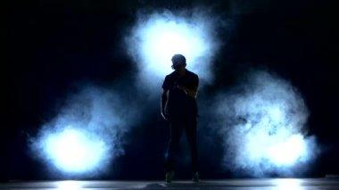 One hip hop break-dancer stylish man in sunglasses dancing, smoke, silhouette — Stock Video
