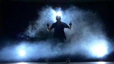 One hip hop break-dancer stylish man in sunglasses dancing, smoke, silhouette, slow motion — Stock Video
