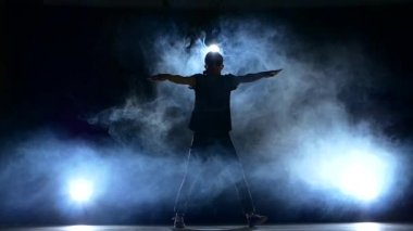 One hip hop break-dancer stylish man dancing, smoke, silhouette, slow motion — Stock Video