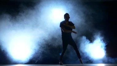 One hip hop break-dancer stylish man starts dancing, smoke, silhouette, slow motion — Stock Video