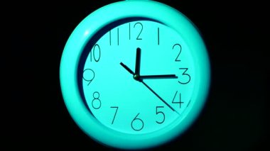 Icon of  blue clock with shadow on black background — 图库视频影像