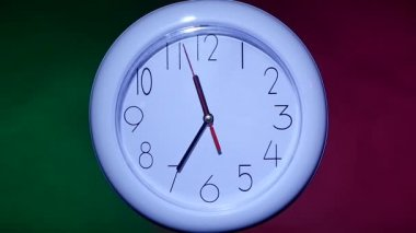 Close up of an office clock on colorful background. slow motion — Stock Video