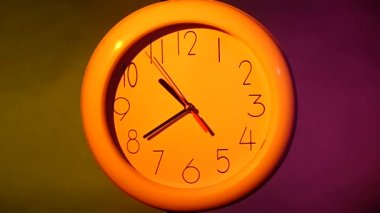 Close up of an yellow clock on colorful background. slow motion — Stock Video