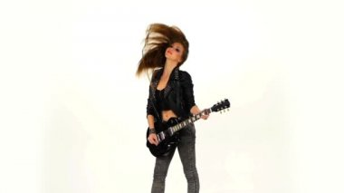 Beautiful young brunette girl with the electric guitar on a white background. Slow motion. — Stock Video