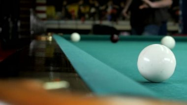 The young man gets into a billiard pocket. — Stock video