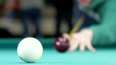 Billiard balls roll on the green table. — Stock video