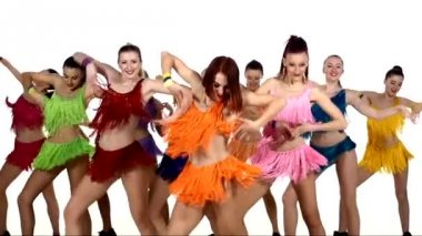 Girls dancing synchronously in colorful dresses over white background. slow motion — Stock Video