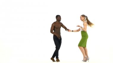 Attractive social latino dancers, european girl and afro american man go on dancing on white — Stockvideo