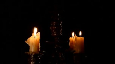 Candle in vintage candlestick — Stock Video