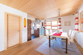 Wooden warm mud of kitchen and dining room in timber house — Photo